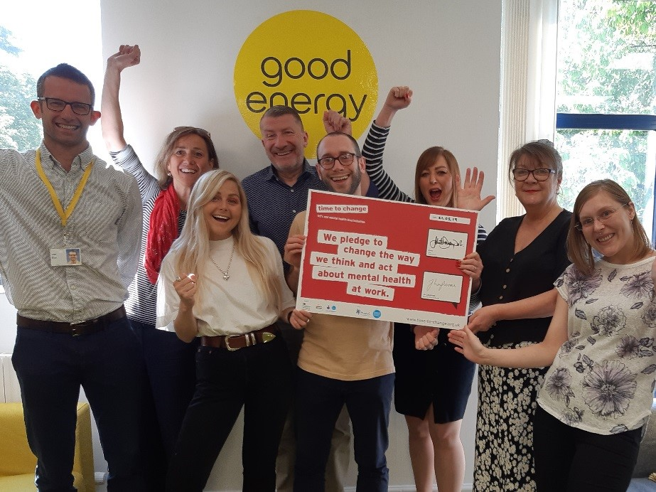 Staff at Good Energy holding a Time to Change Pledge sign
