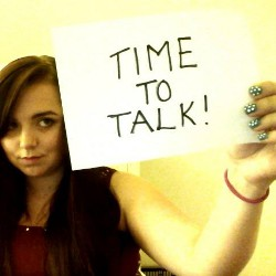 """Kerry holding """"time to talk"""" sign"""