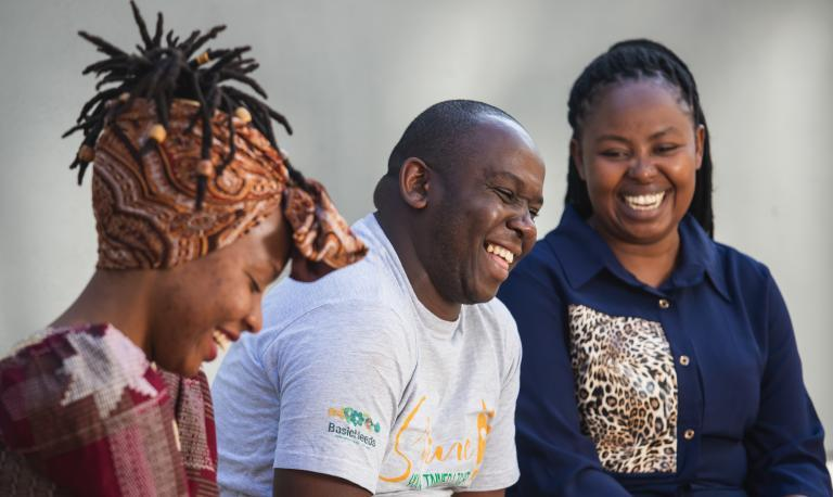 three people talking and laughing