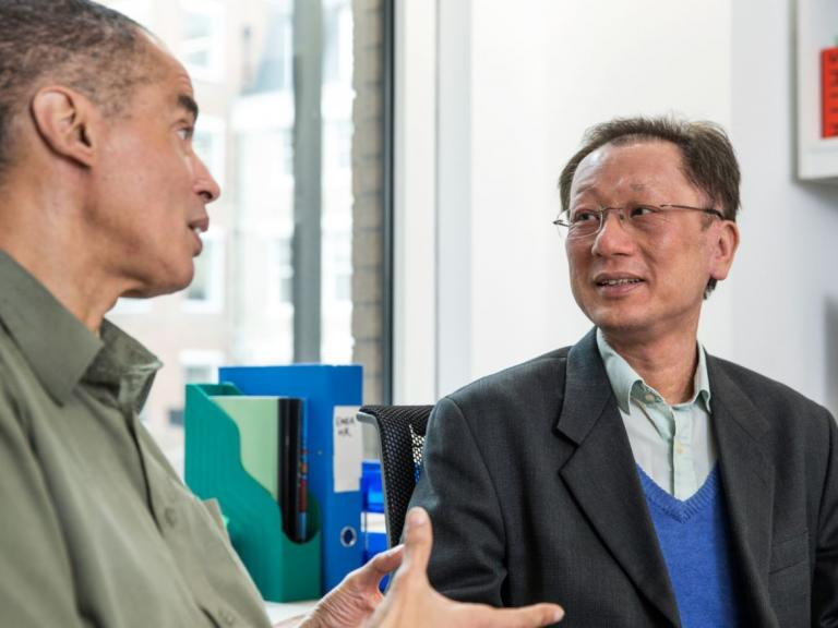 two men talking to each other